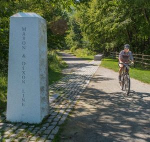 Great Allegheny Passage, rider at Mason Dixon Line,