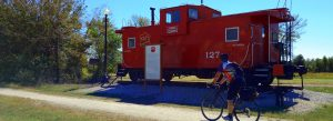 Missouri's Katy Trail caboose with rider