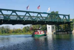 Brockport boat under bridge